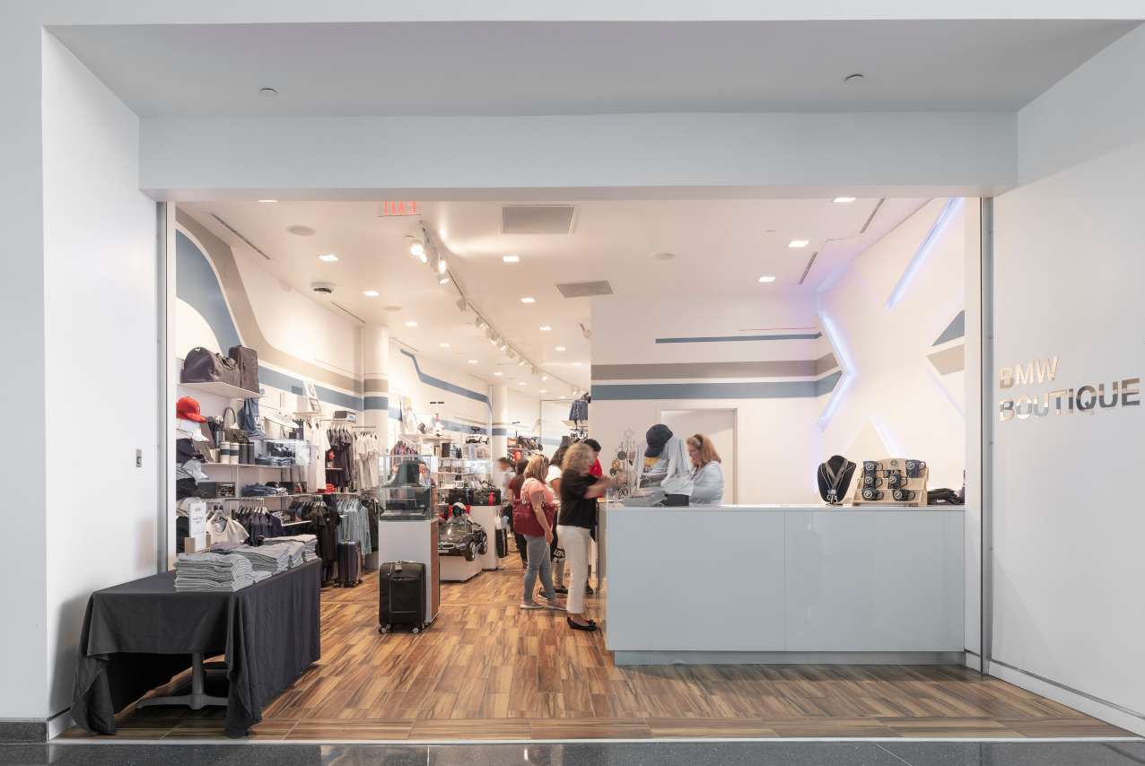 people purchasing items in the BMW boutique gift shop