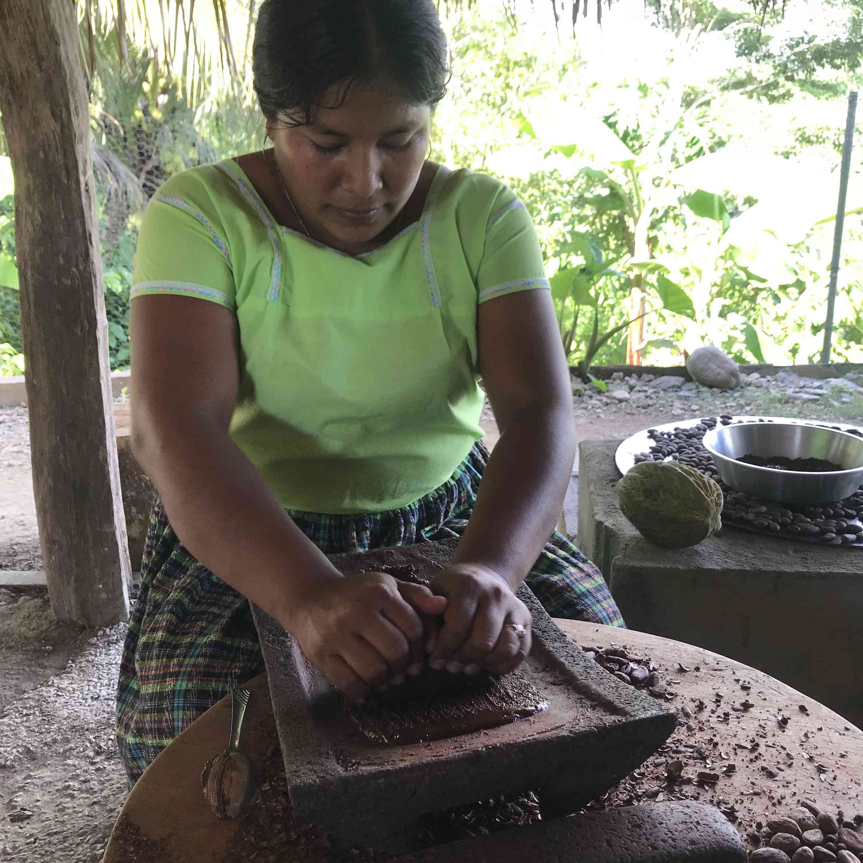 Victoria Pop crushing cacao beans