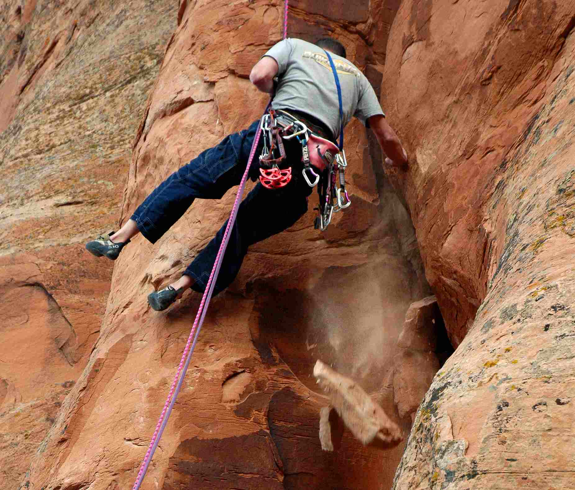 Ian Spencer-Green cleans loose blocks from a crack in western Colorado.