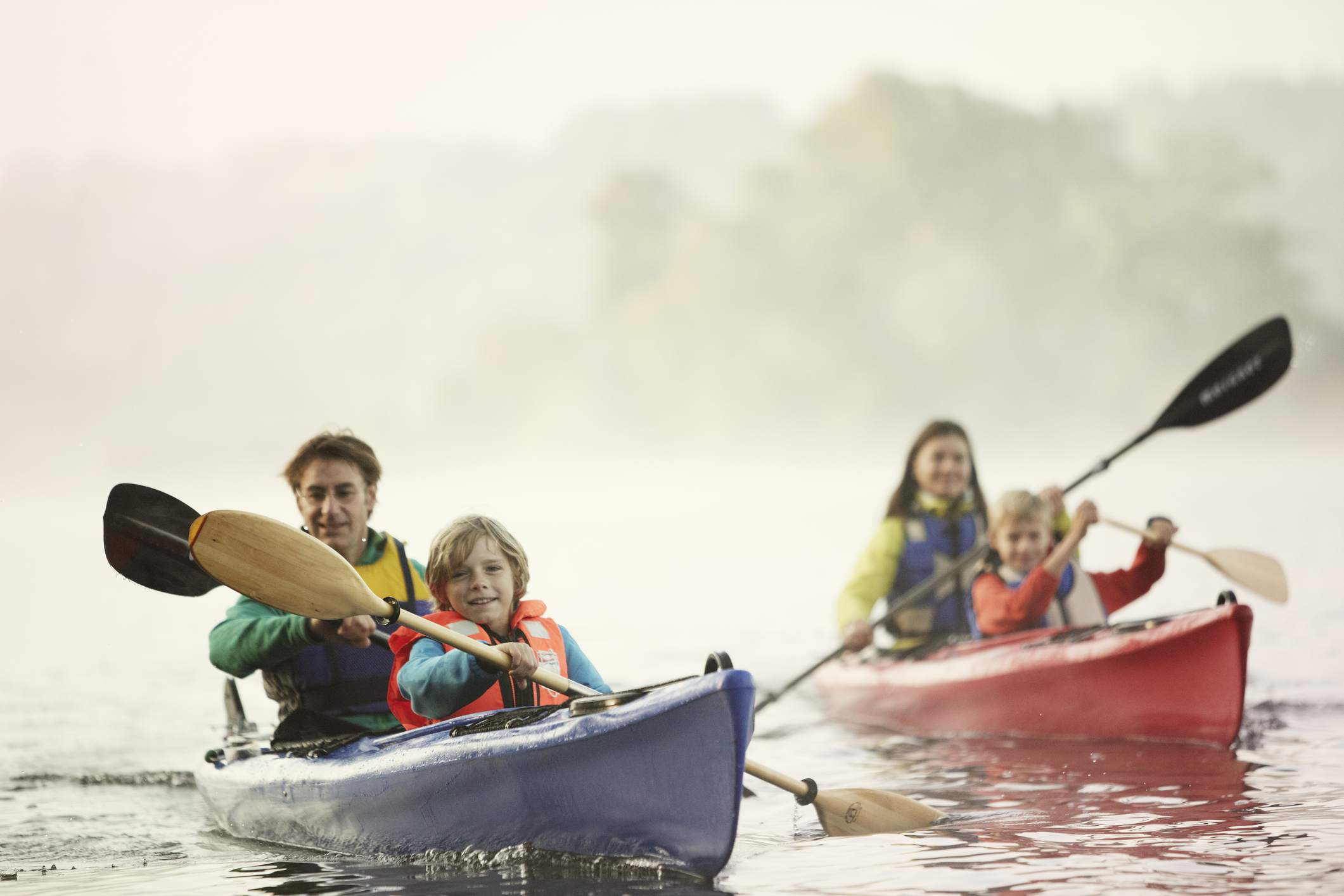 A family kayaking on a river.