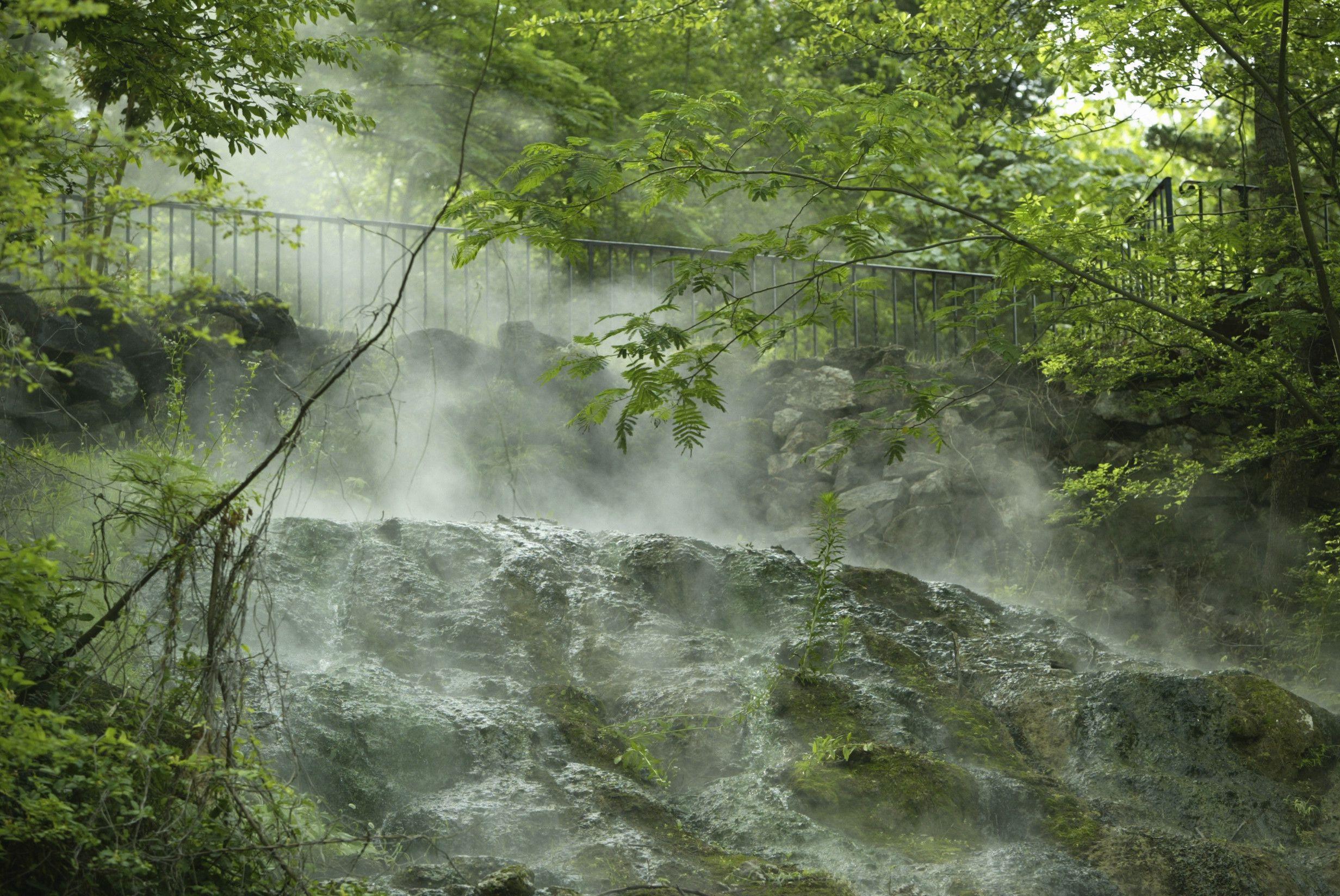 Arkansas, Hot Springs, steam rises from a hot spring at Arlington Lawn in Hot Springs National Park.