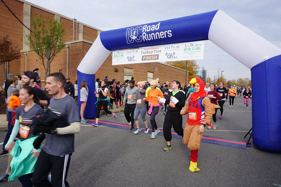 Runners in the Alexandria Turkey Trot cross the finish line.