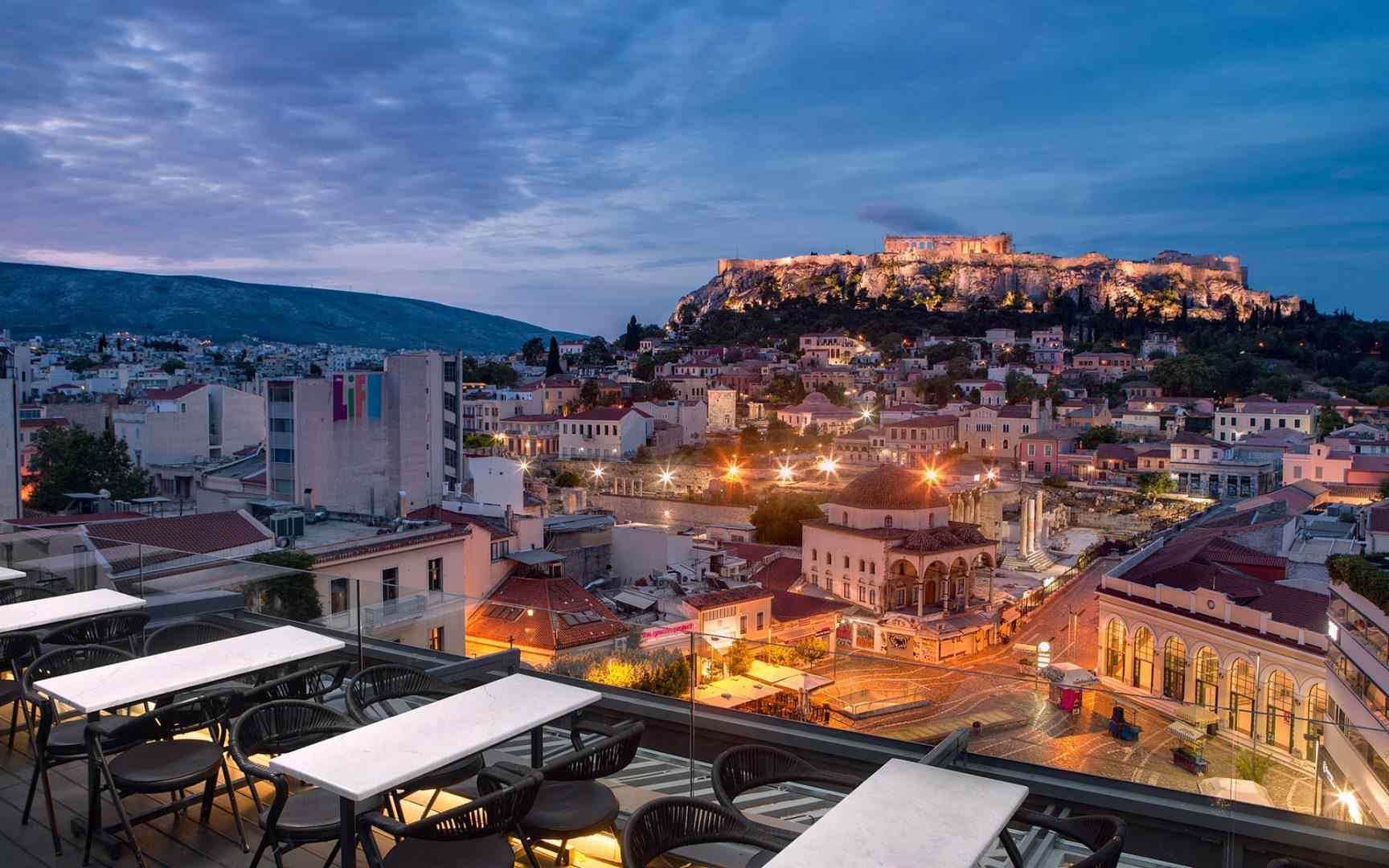 A for Athens bar during early evening with view of the Acropolis in the background