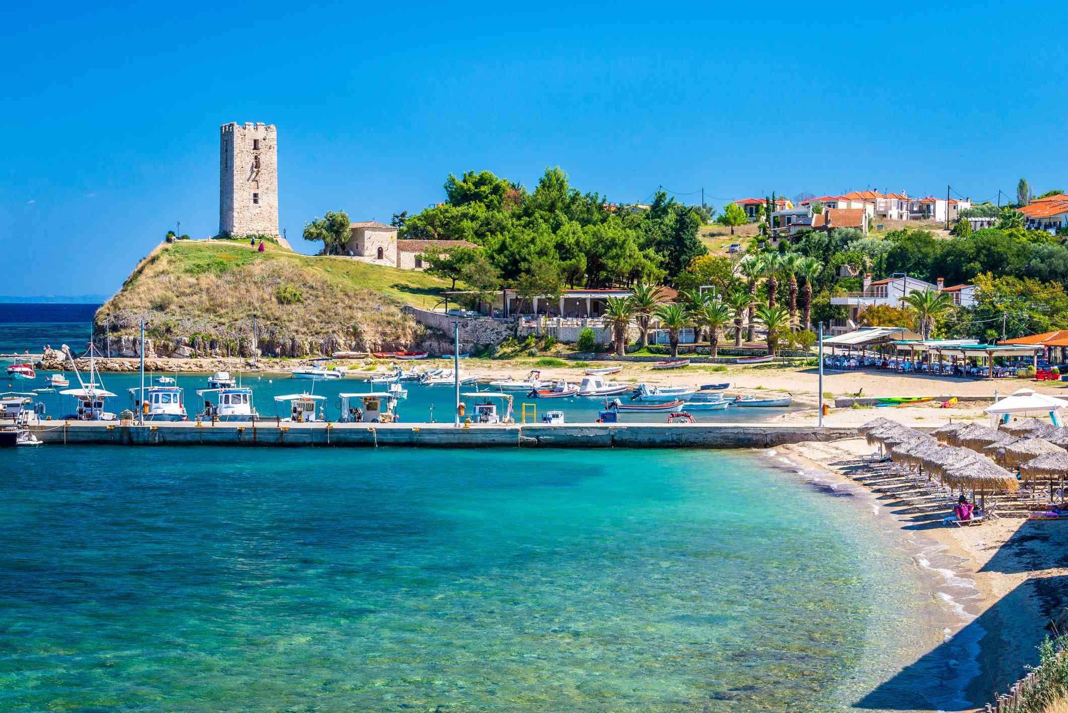 Old tower, pier and beach, Nea Fokea, Kassandra, Halkidiki, Greece