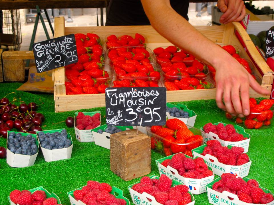 Fresh red fruits and berries at the Aligre food market in Paris