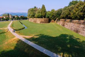 A walking path leading to the historic walls of Lucca