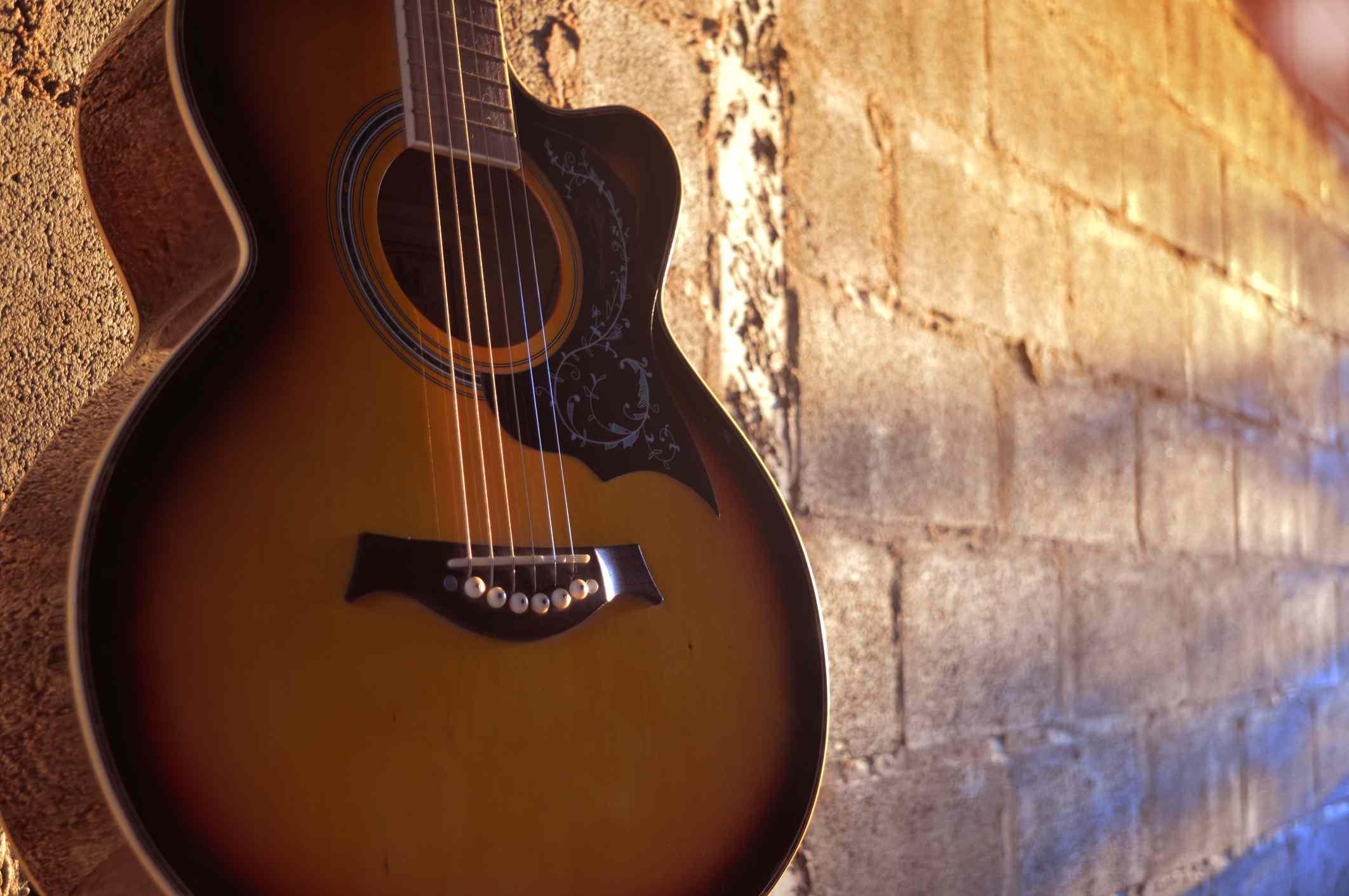 Guitar on brick wall