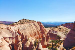 Scenic View Of Rocky Mountains At Kasha-Katuwe Tent Rocks National Monument Against Clear Blue Sky