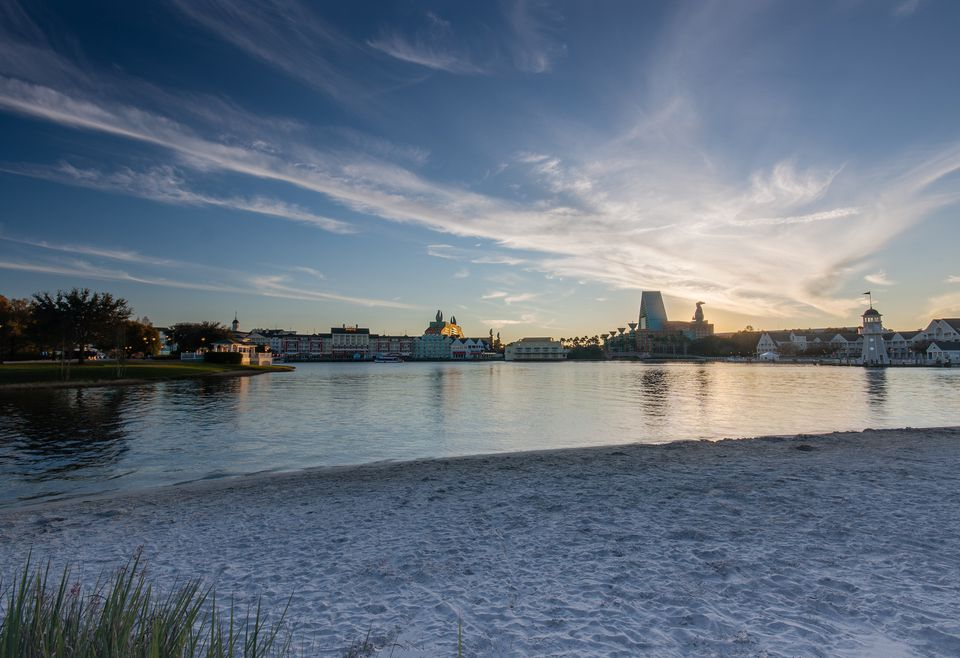 Boardwalk Disney area with Swan and Dolphin hotel on Crescent Lake shore at sunset in Orlando