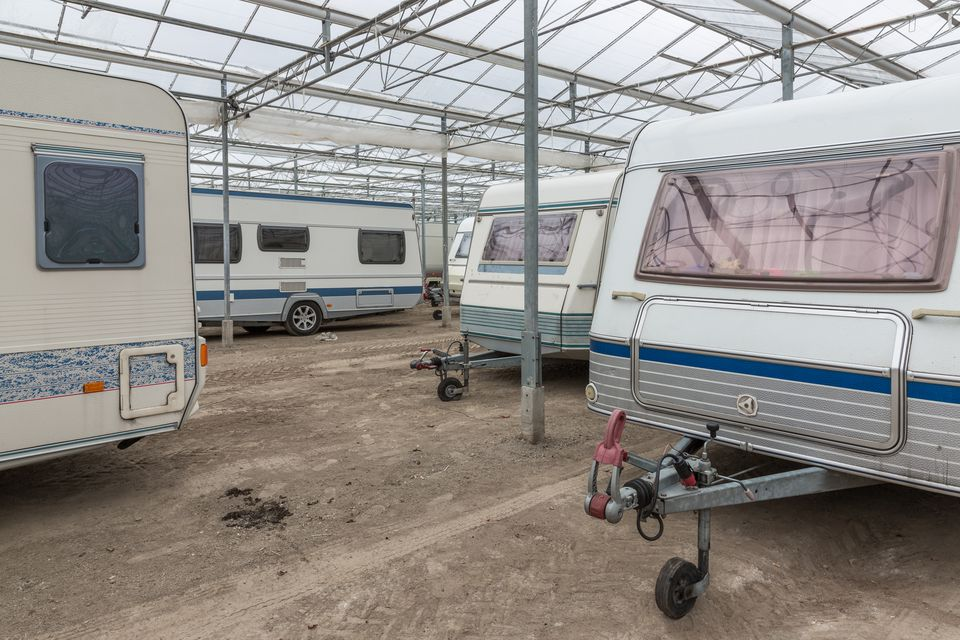 RVs parked in an empty greenhouse