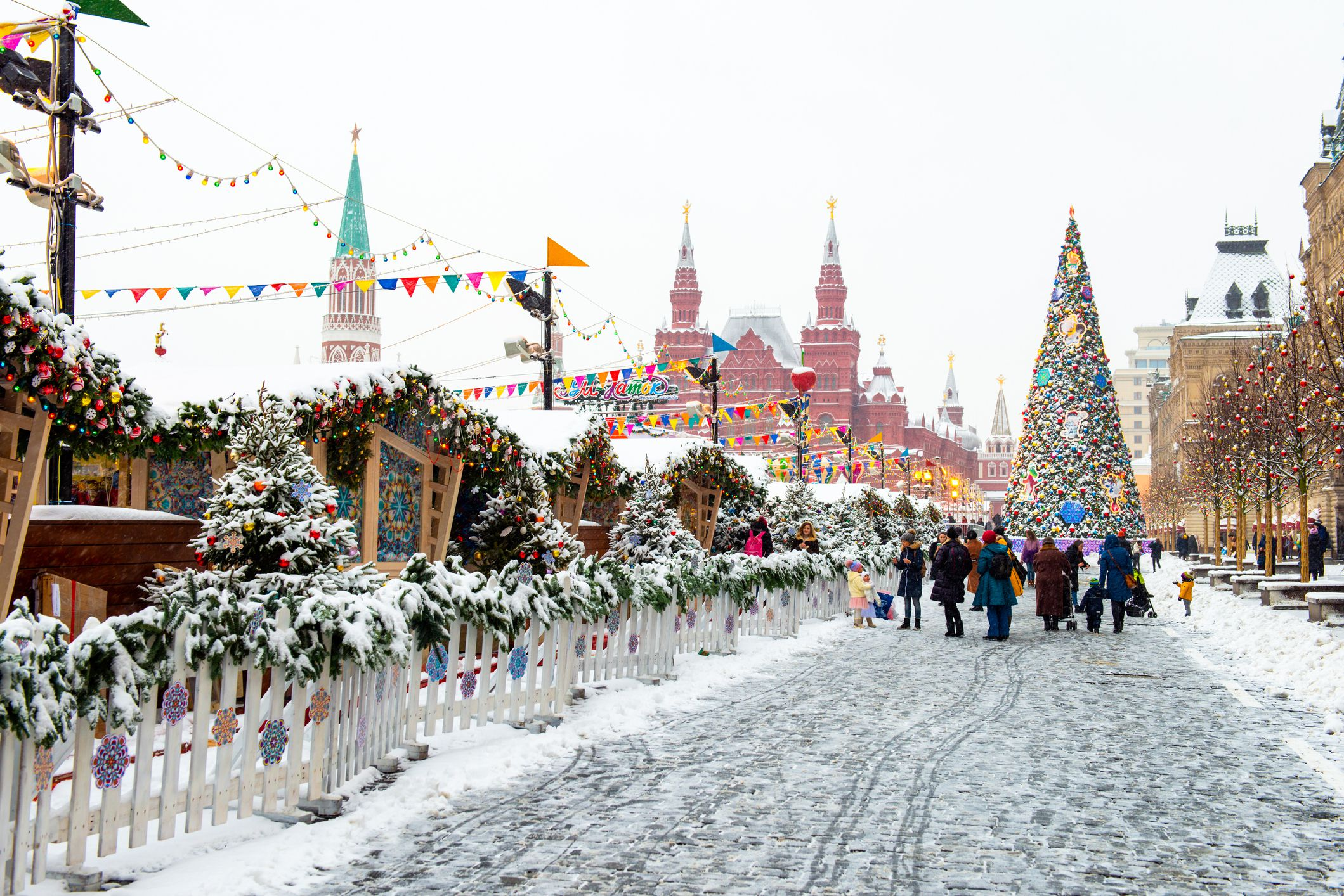 Snowy Red Square in Moscow. People preparing for Christmas and New year. Winter walk on the street.