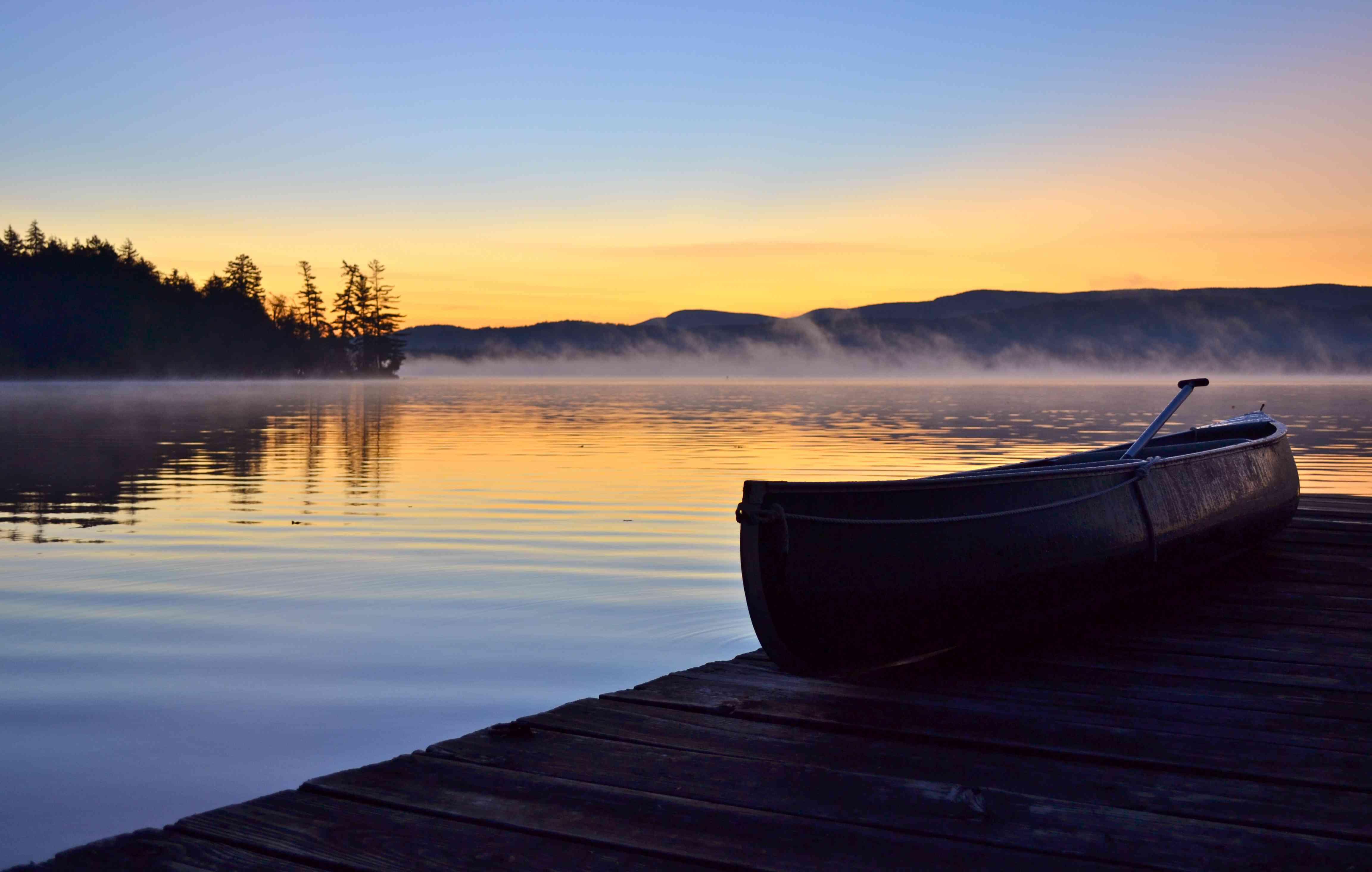 Canoe on jetty at Raquette Lake, Adirondack Mountains, New York State, USA