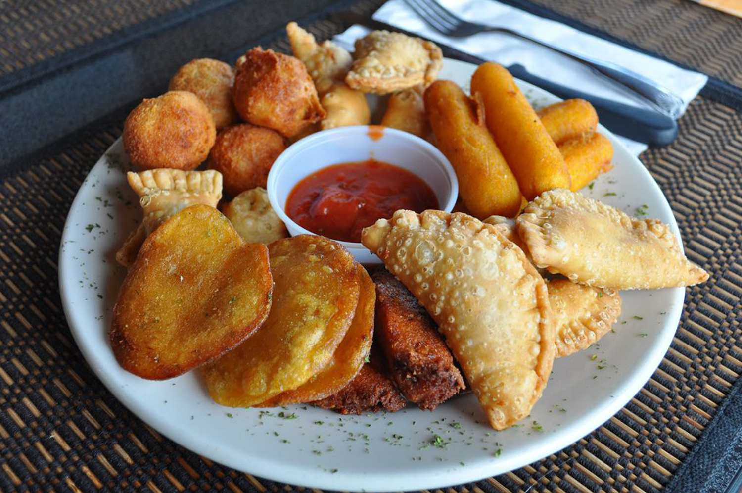 Alcapurrias Fritters with dipping sauce