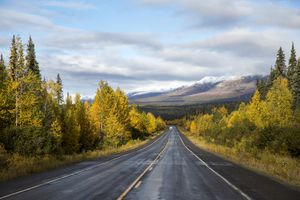 An RV heads down the George Parks Highway in Alaska on a fall day