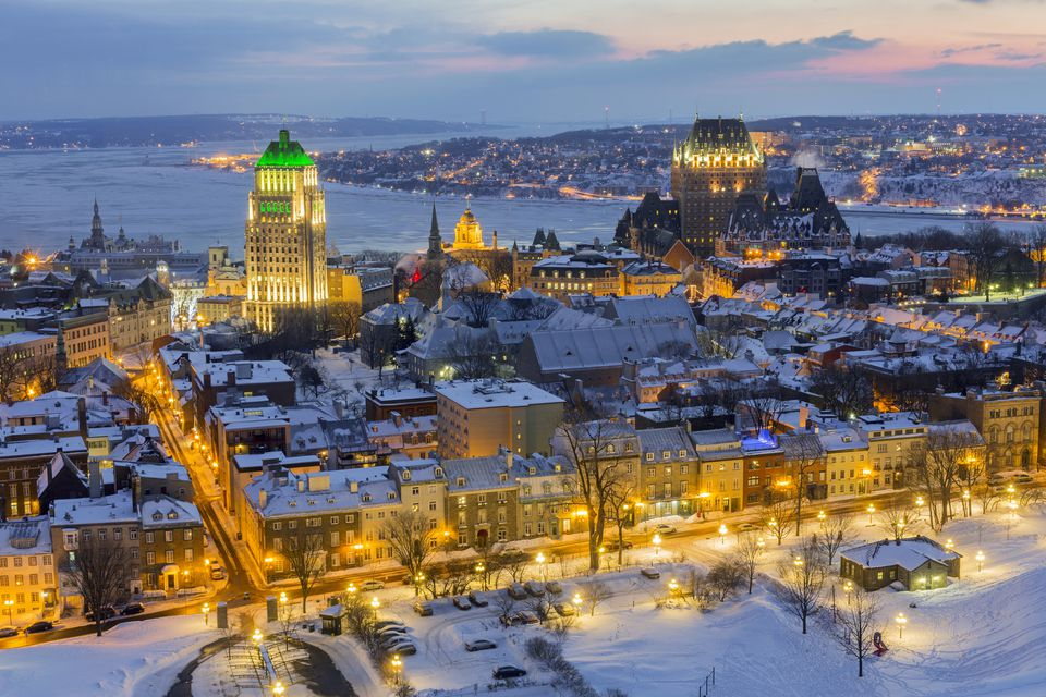 Quebec City lit up at nighttime during winter