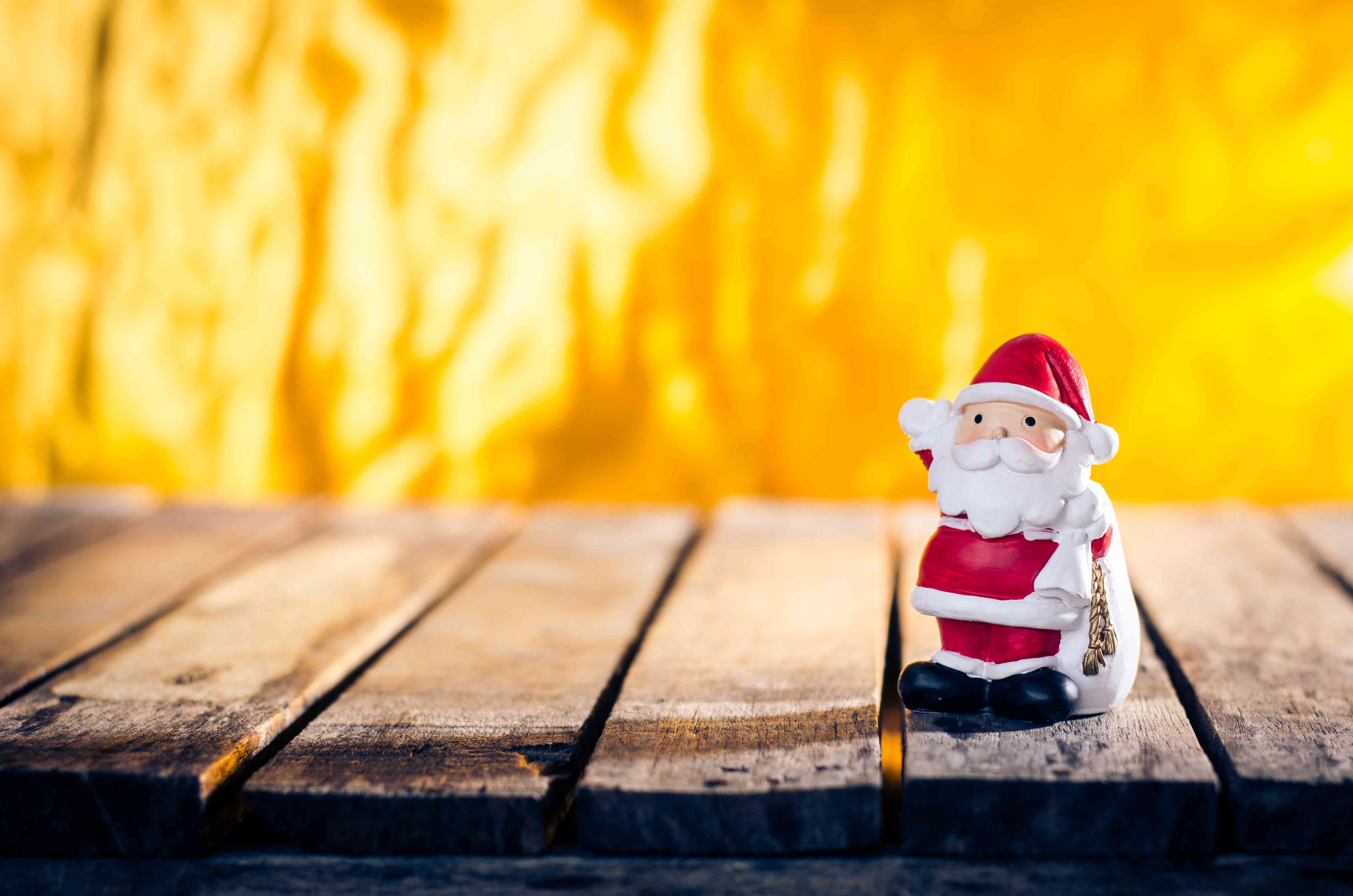 A small Santa on wooden walkway in Thailand