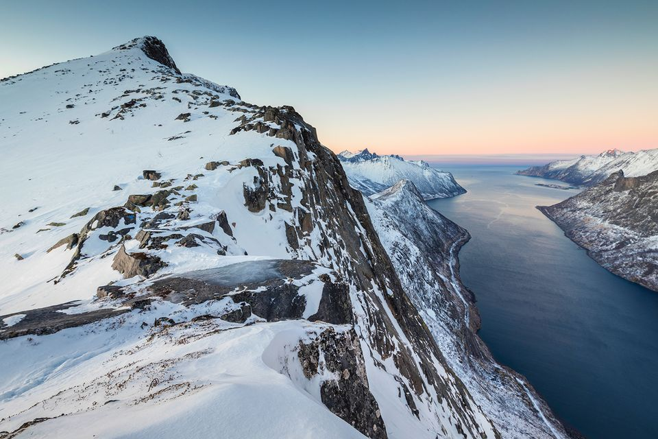 Snowy mountains and frozen sea.