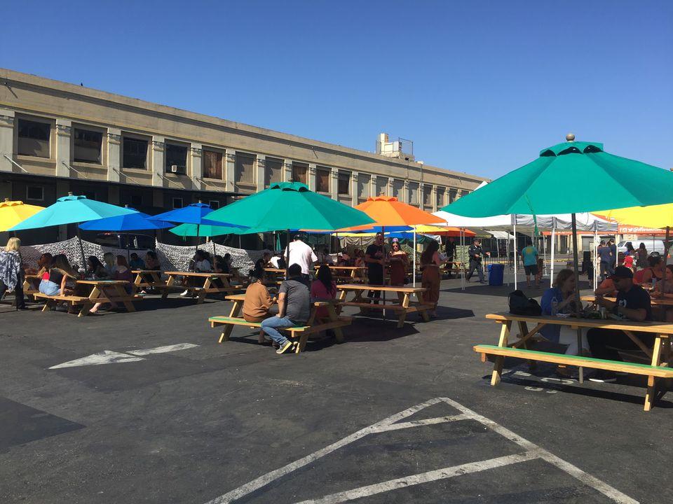 Picnic tables with umbrellas at Smorgasburg LA