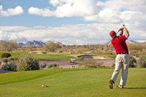 Male Caucasian Golfer on the Tee Desert Golf Course