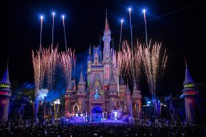 Cinderella's Castle during a show with fireworks and projections