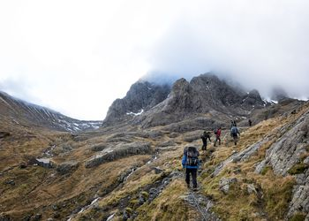 Hikers on the route up Ben Nevis, Scotland