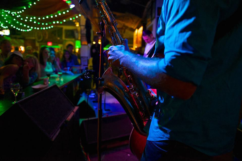 Jim Powell playing the saxophone at the green parrot bar