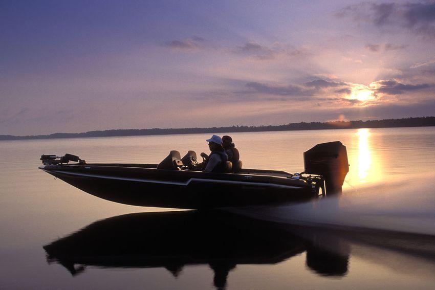 Men speed across open water in a boat