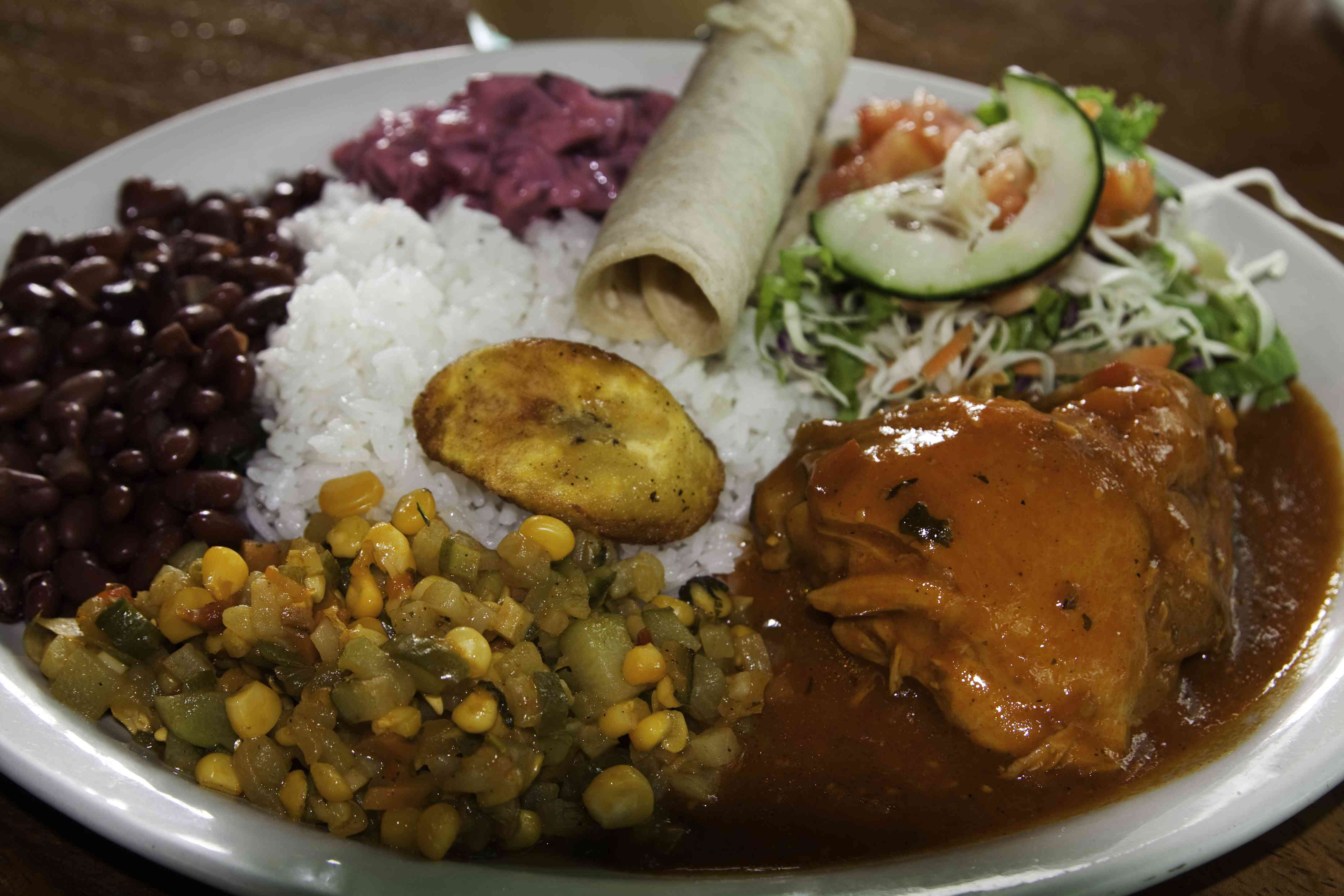 Typical casado Costa Rican lunch: chicken with rice and beans, vegetables and fried plantains.
