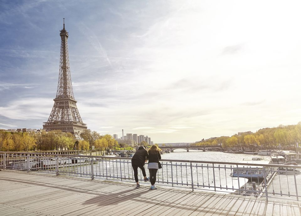 Tourist couple looking at The Eiffel Tower, Paris, France