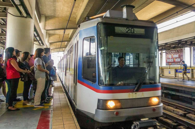 MRT pulling into North Avenue Station, Manila, Philippines