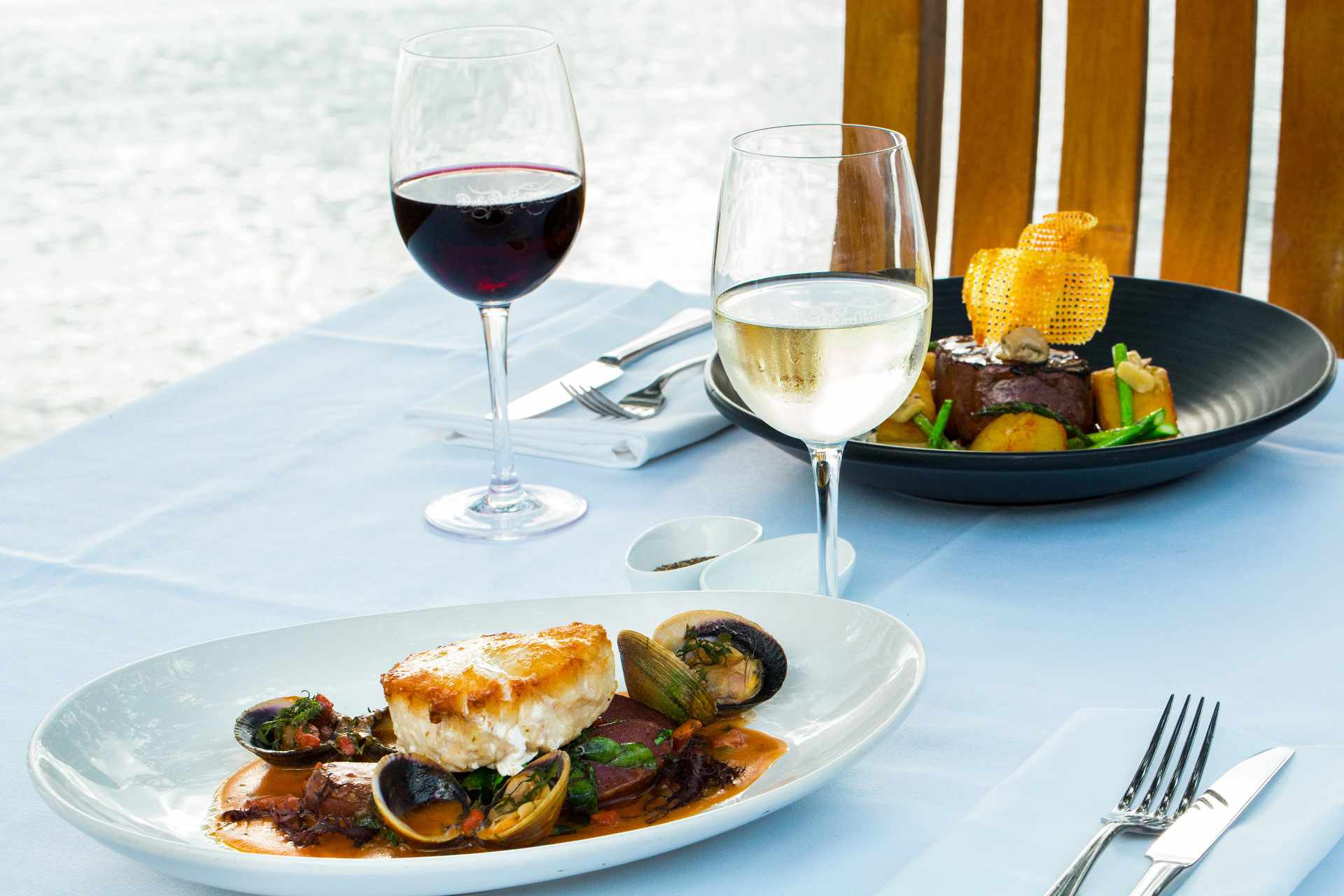 Fish and steak entree at the Duke of Marlborough Hotel Restuarant with a glass white and a glass of red wine