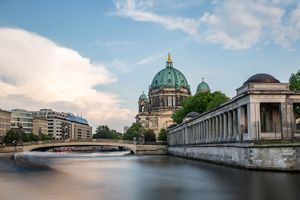 A bridge to Museum Island with the water rushing by