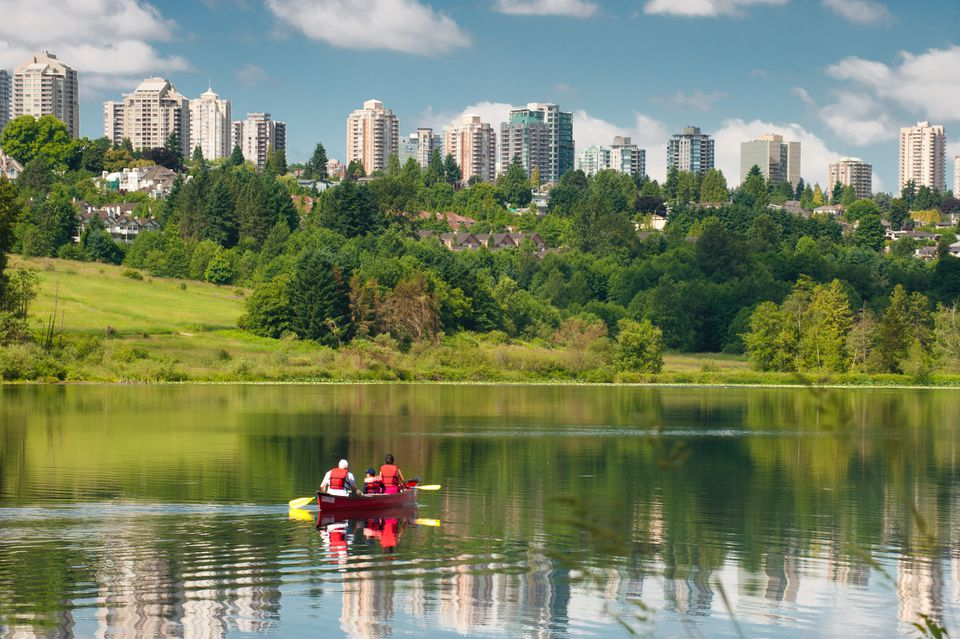 Family kayaking on deer lake, burnaby BC.