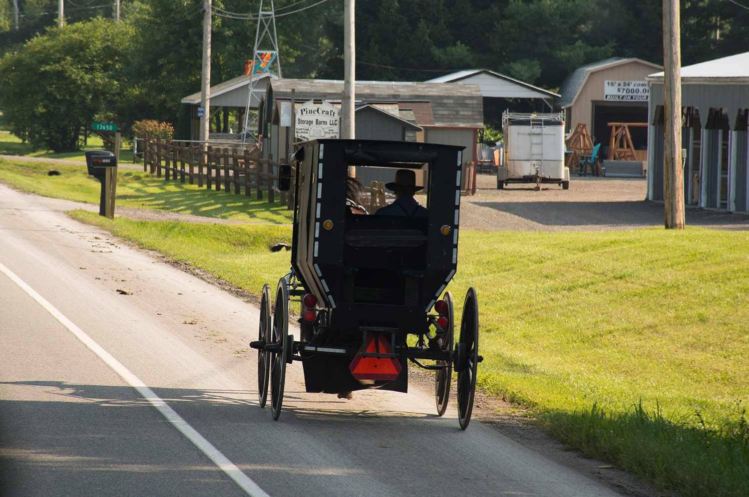 Amish horse carriage on road in Middlefield