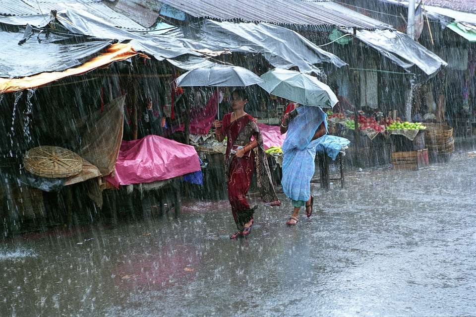 People walking during monsoon season in India