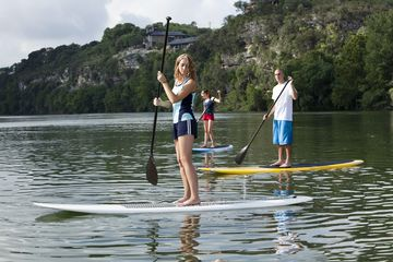Young adults paddleboarding