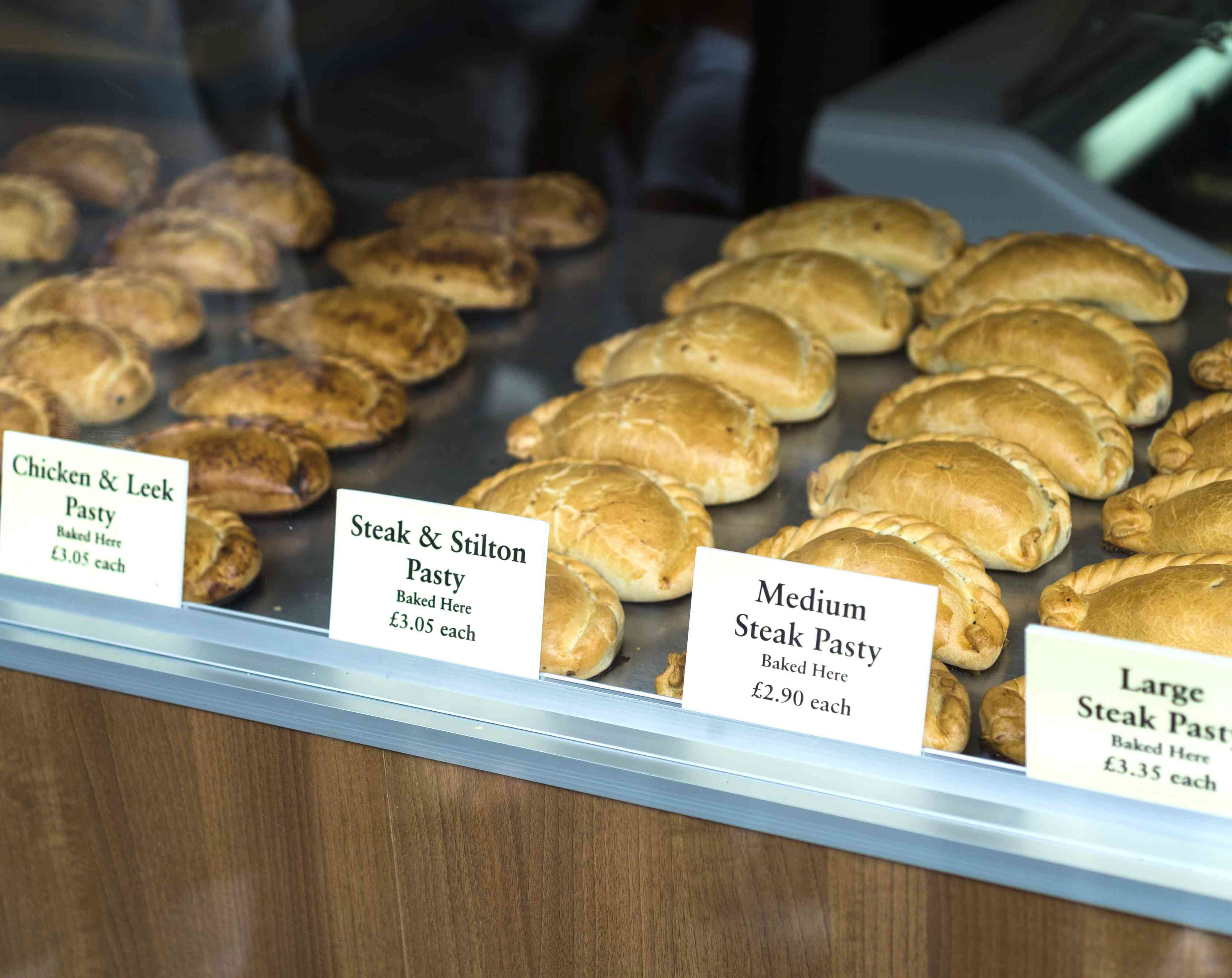 Different pasties being displayed in a windows shop in Cornwall