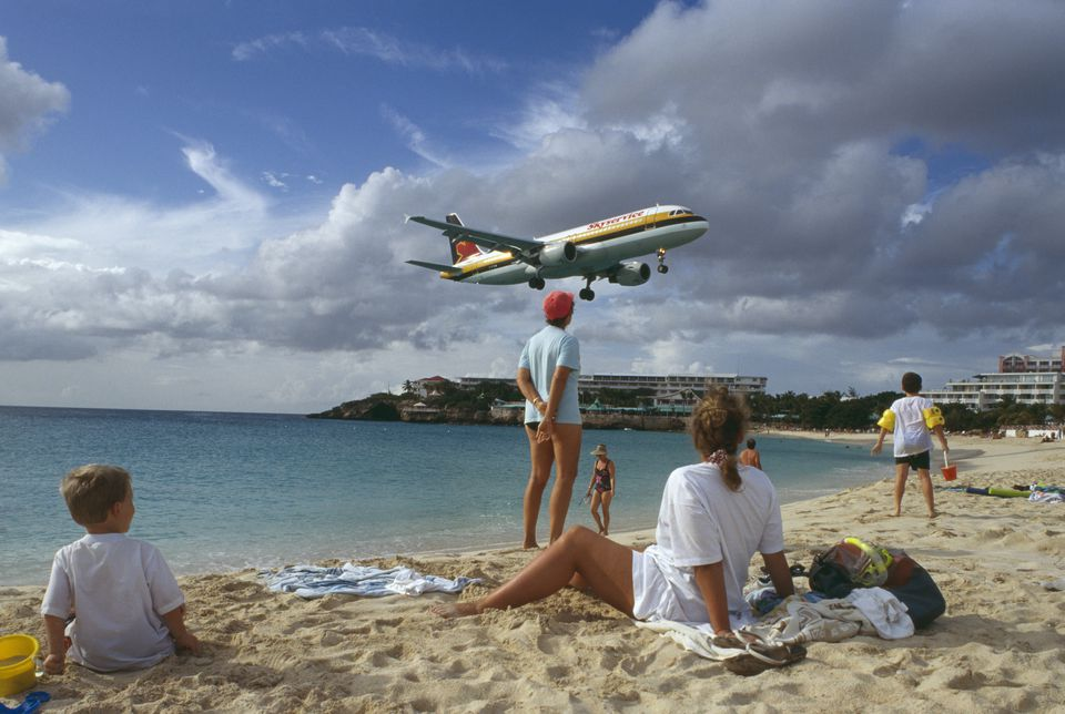 People at Maho Beach Watching Landing Plane