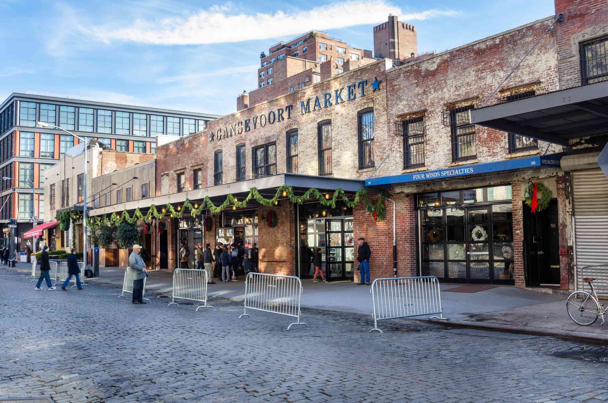 Exterior of Gansevoort Market with several people waiting outside the doors