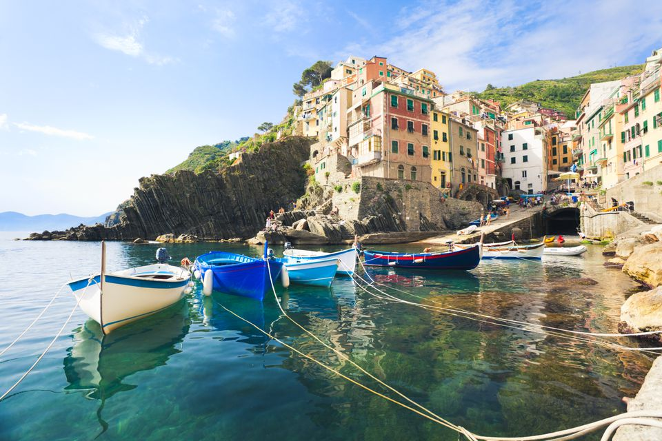 Riomaggiore harbor, with boats in foreground and town in the distance