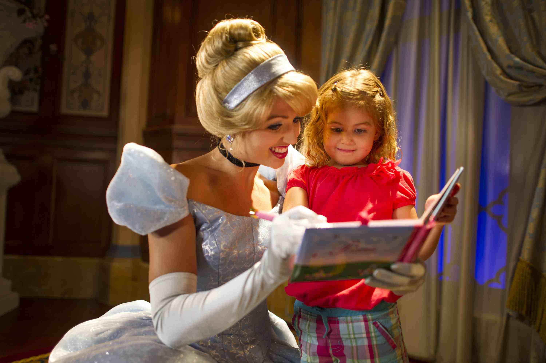 Cinderella signing a book at Princess Fairytale Hall
