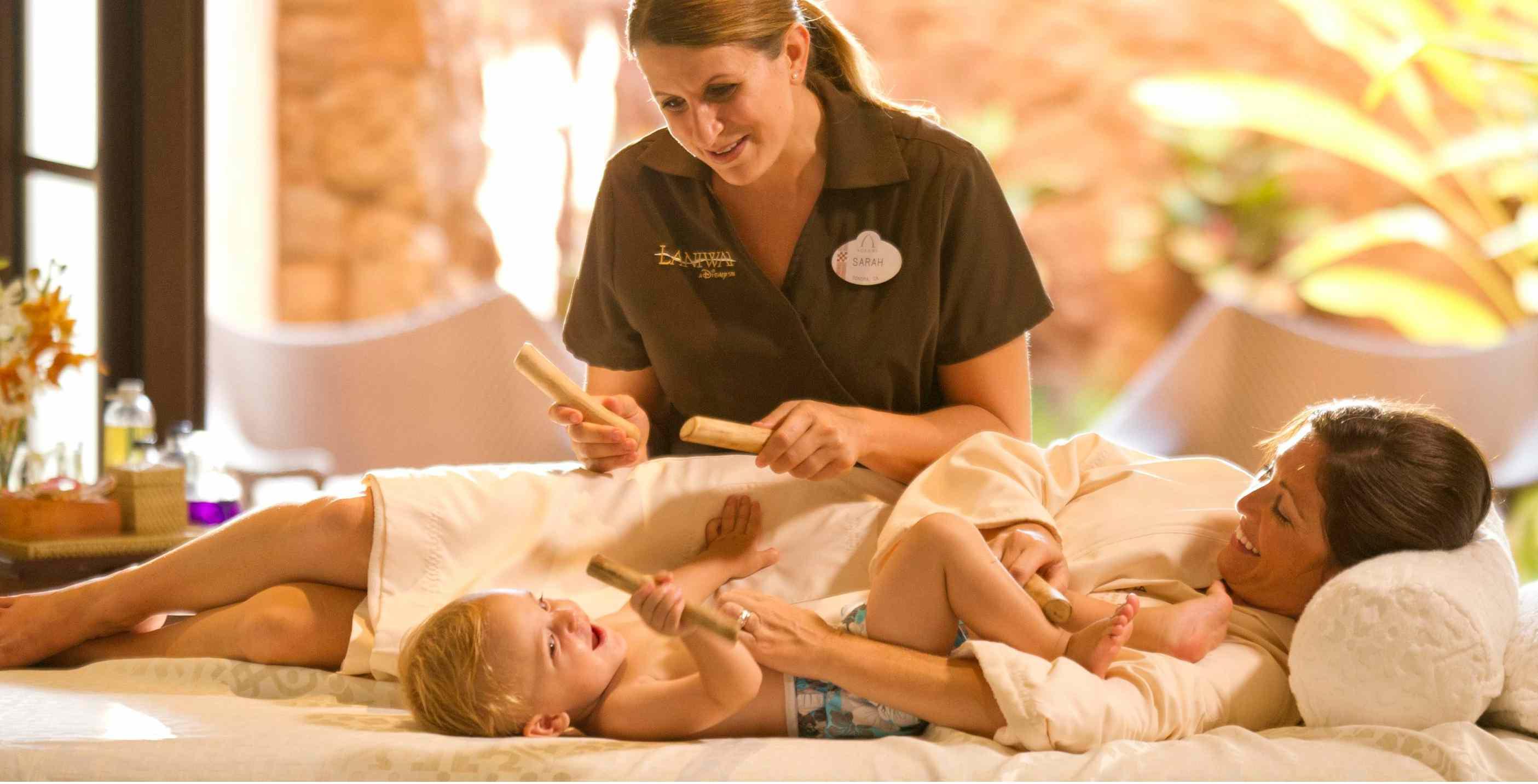 Mother and baby enjoy a massage at the Laniwai Spa at Aulani