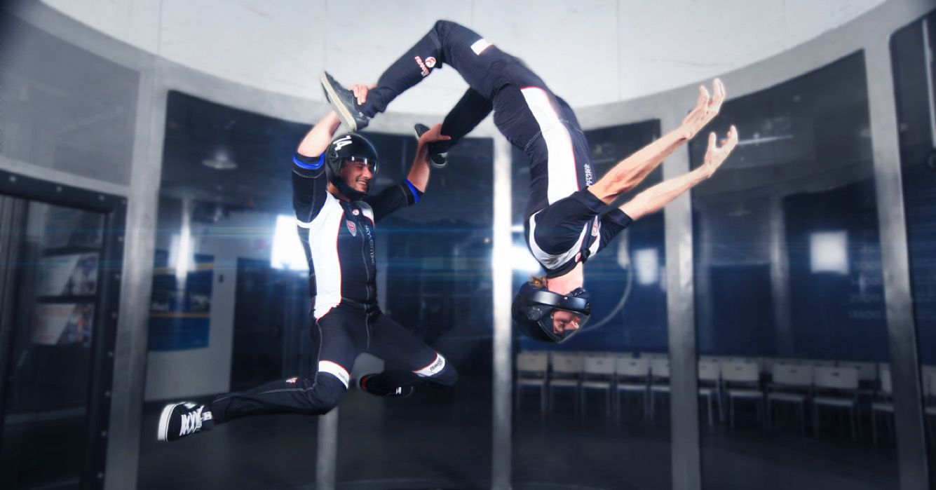 Two people in the air at SkyVenture in Laval Quebec