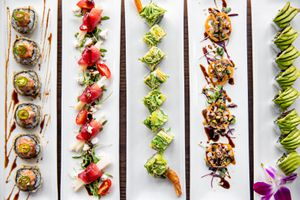 Five rectangular plates of different sushi from O-Ku photographed from above