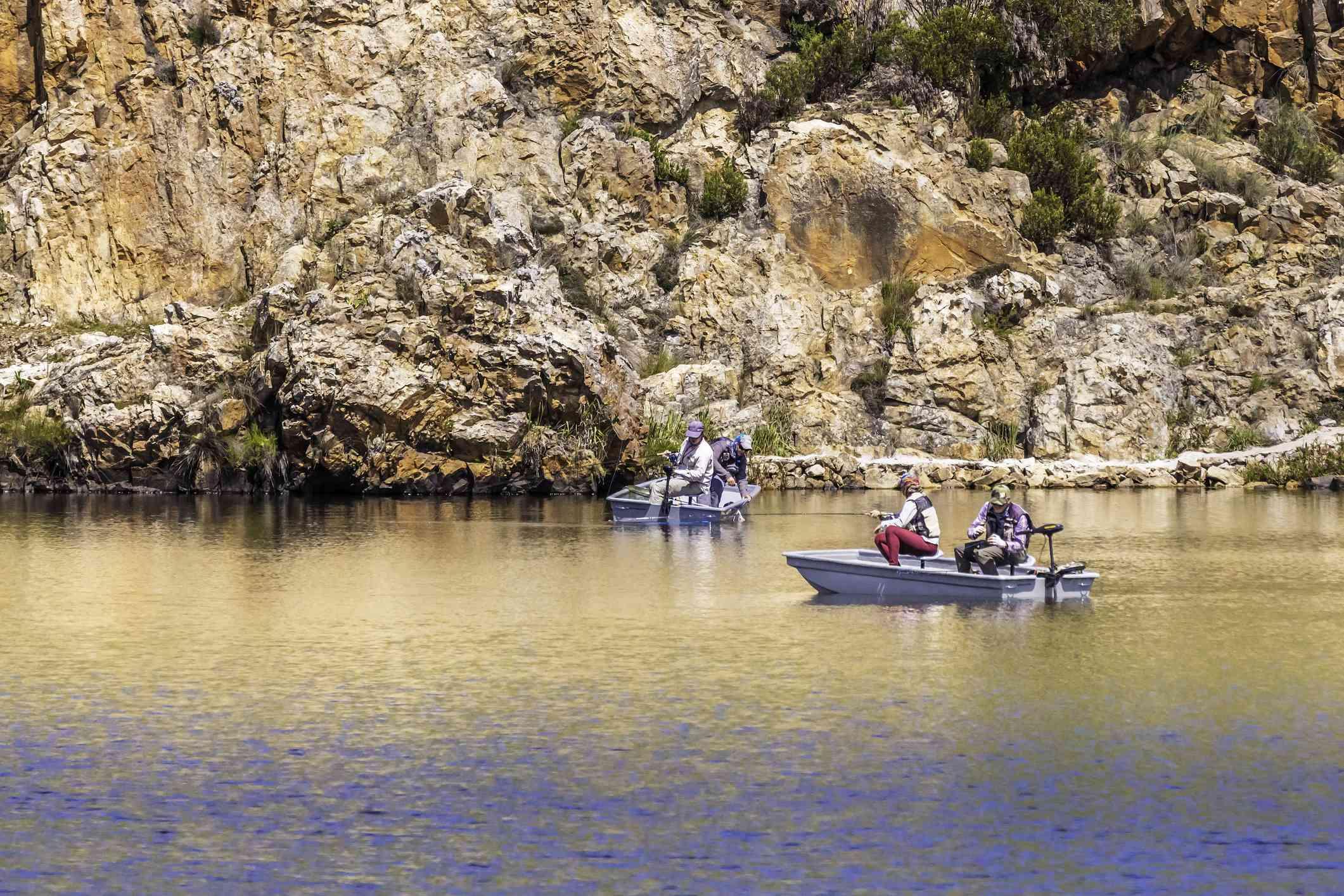 Fishermen fresh water fishing in Dullstroom, South Africa