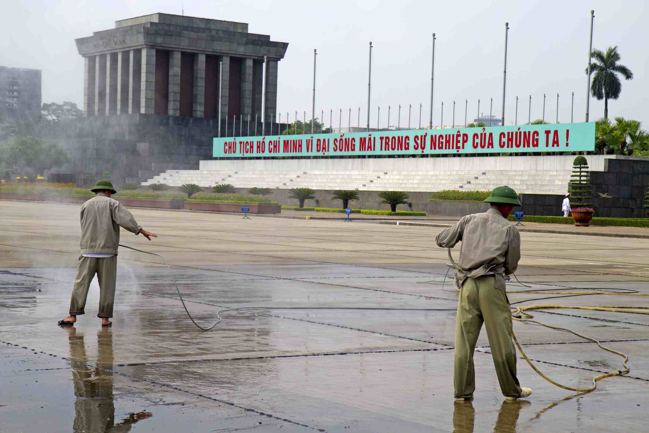 Cleaning the grounds at Ho Chi Minh's mausoleum