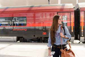 Woman arriving in train station