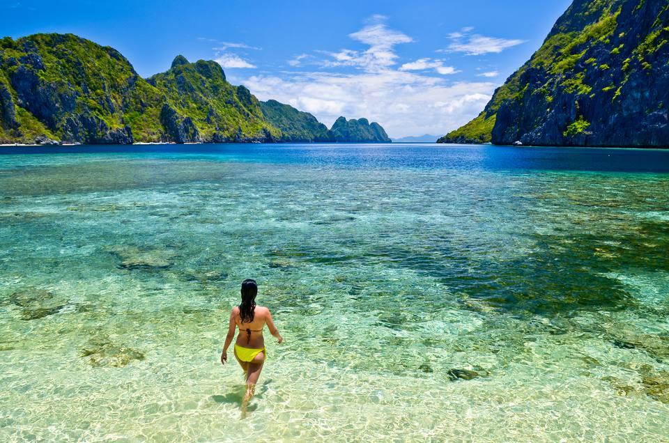 Girl enjoying El Nido island beach