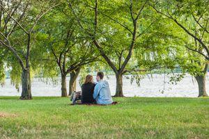 Romantic couple having a picnic by the Potomac River