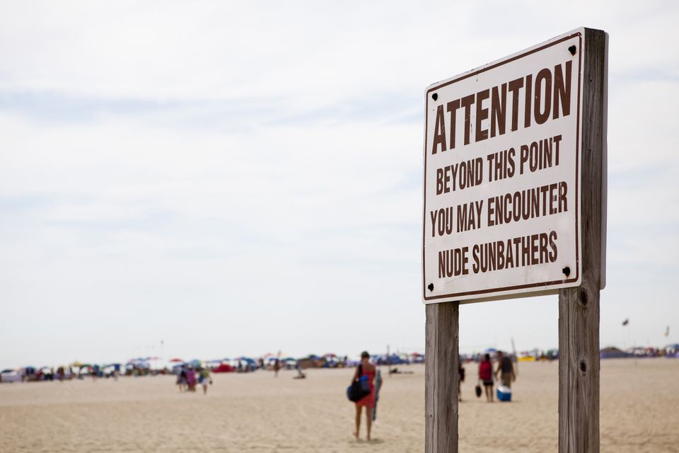 Nude beach warning sign